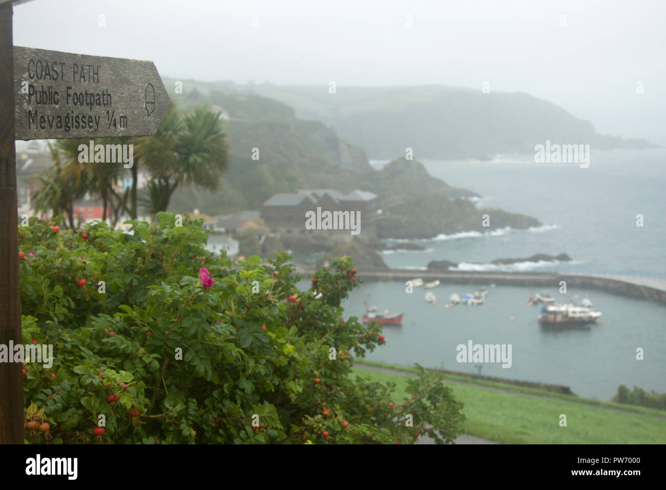 Public footpath sign pointing to Mevagissey - Stock Image