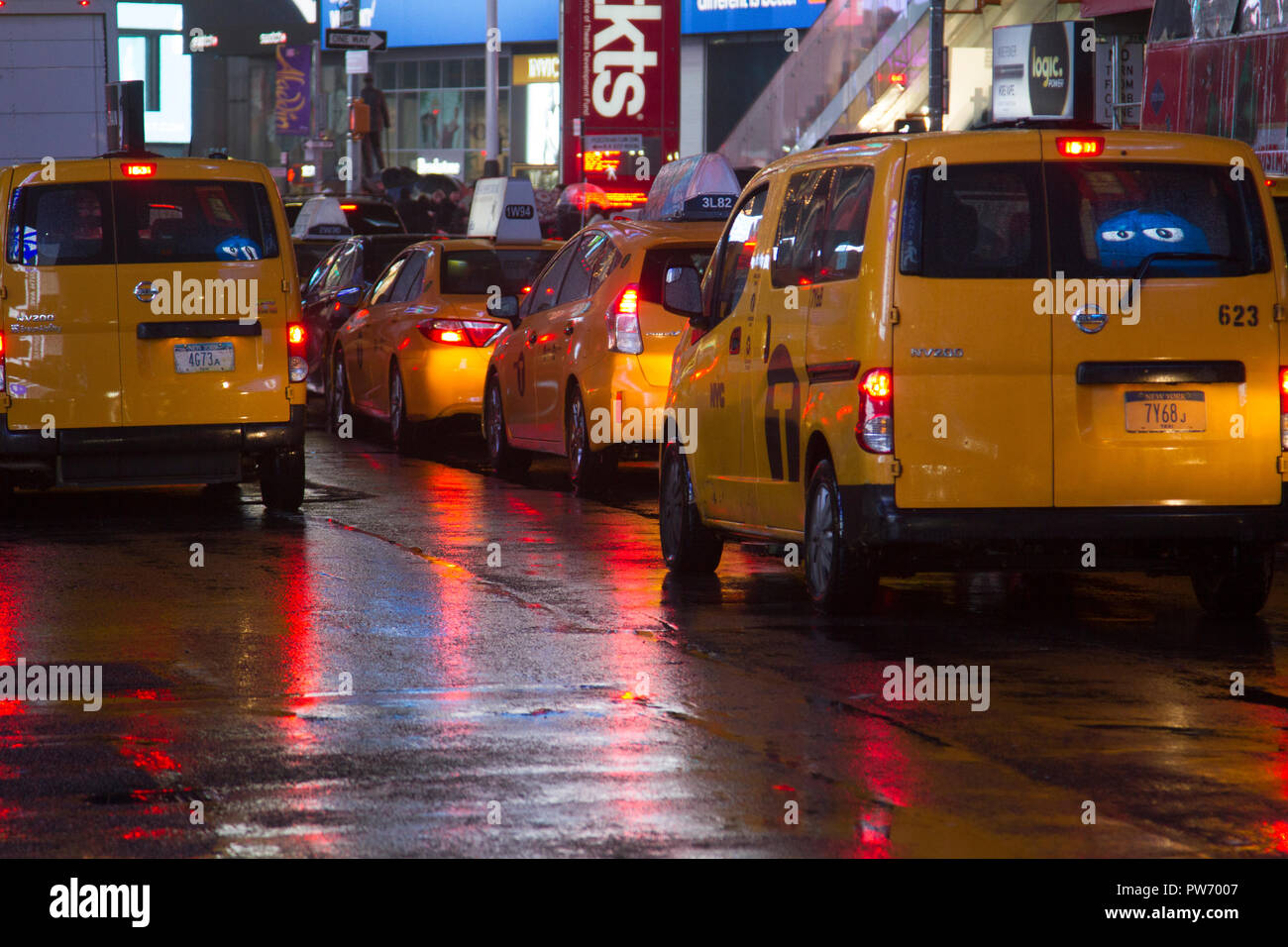 Yellow cabs in the rain, Time Square, New York, USA Stock Photo