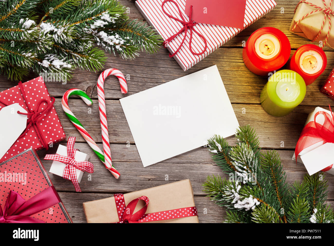Christmas gift boxes and candles on wooden table. Top view with xmas ...