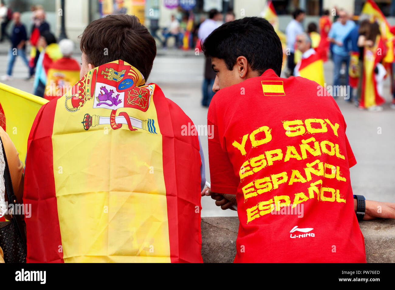 Two youths at a pro-Spain/ anti-Catalan independence rally, Barcelona, Spain. - Stock Image