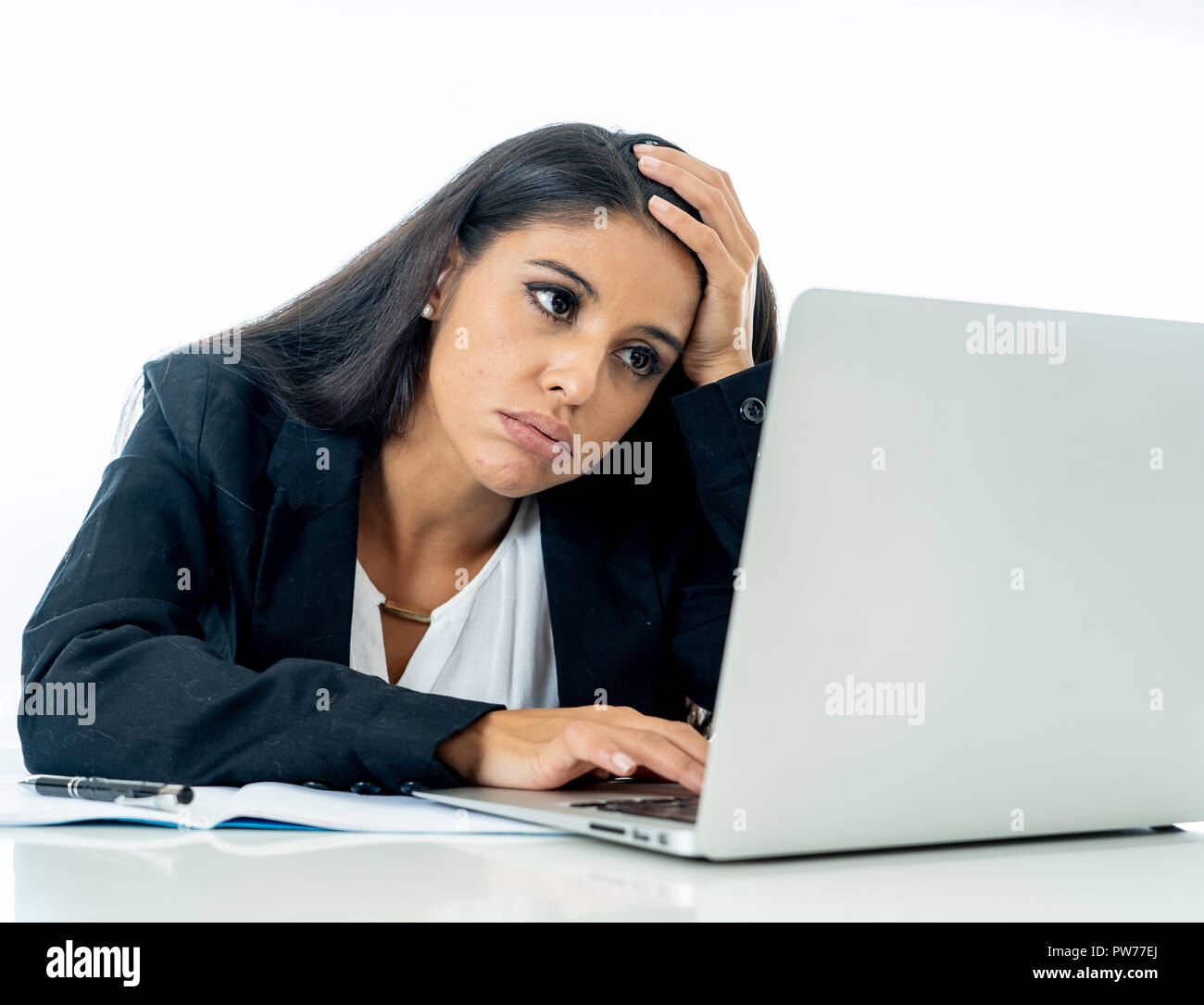 Young attractive businesswoman desperate and frustrated working on computer laptop at office in overtime and non fulfillment of ones hopes or professi - Stock Image