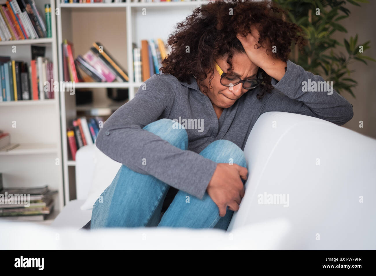 Black woman trying to get over relationship breakup - Stock Image