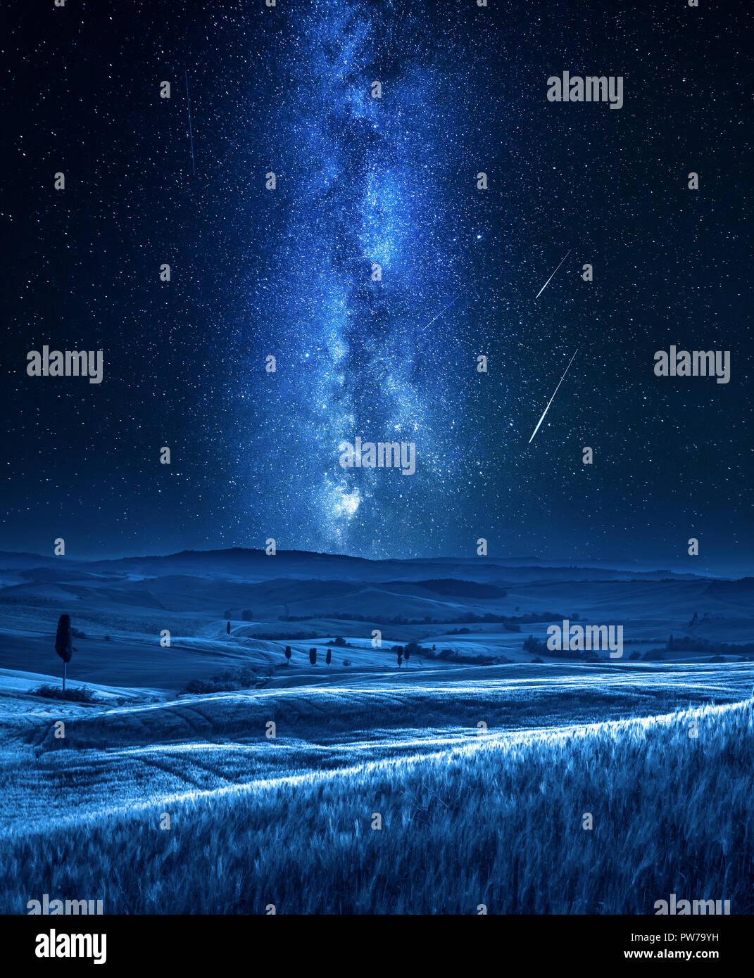 Milky way and falling stars in Tuscany at night, Italy Stock Photo