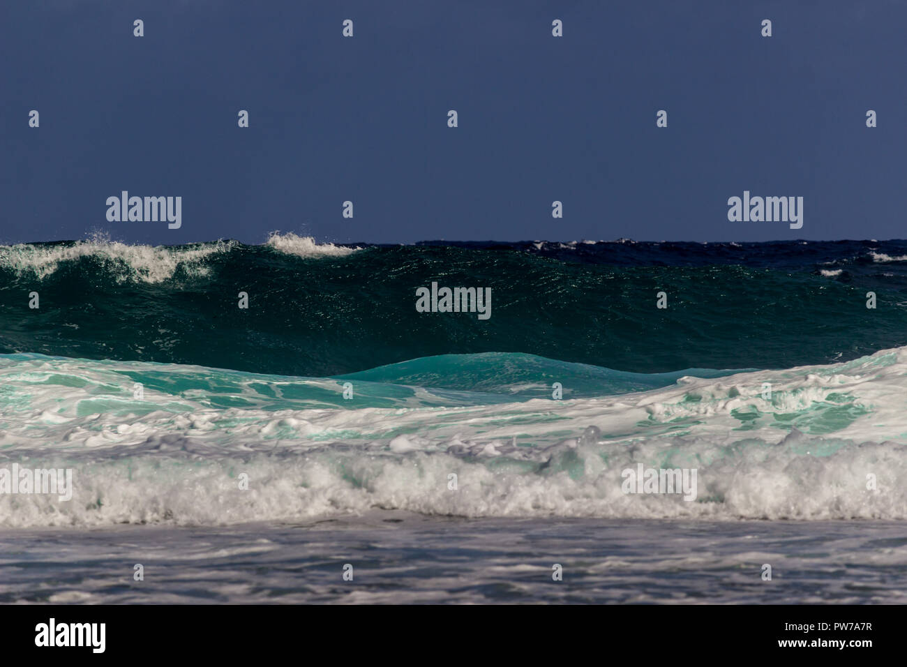 Crashing waves in tropical turquoise water. - Stock Image
