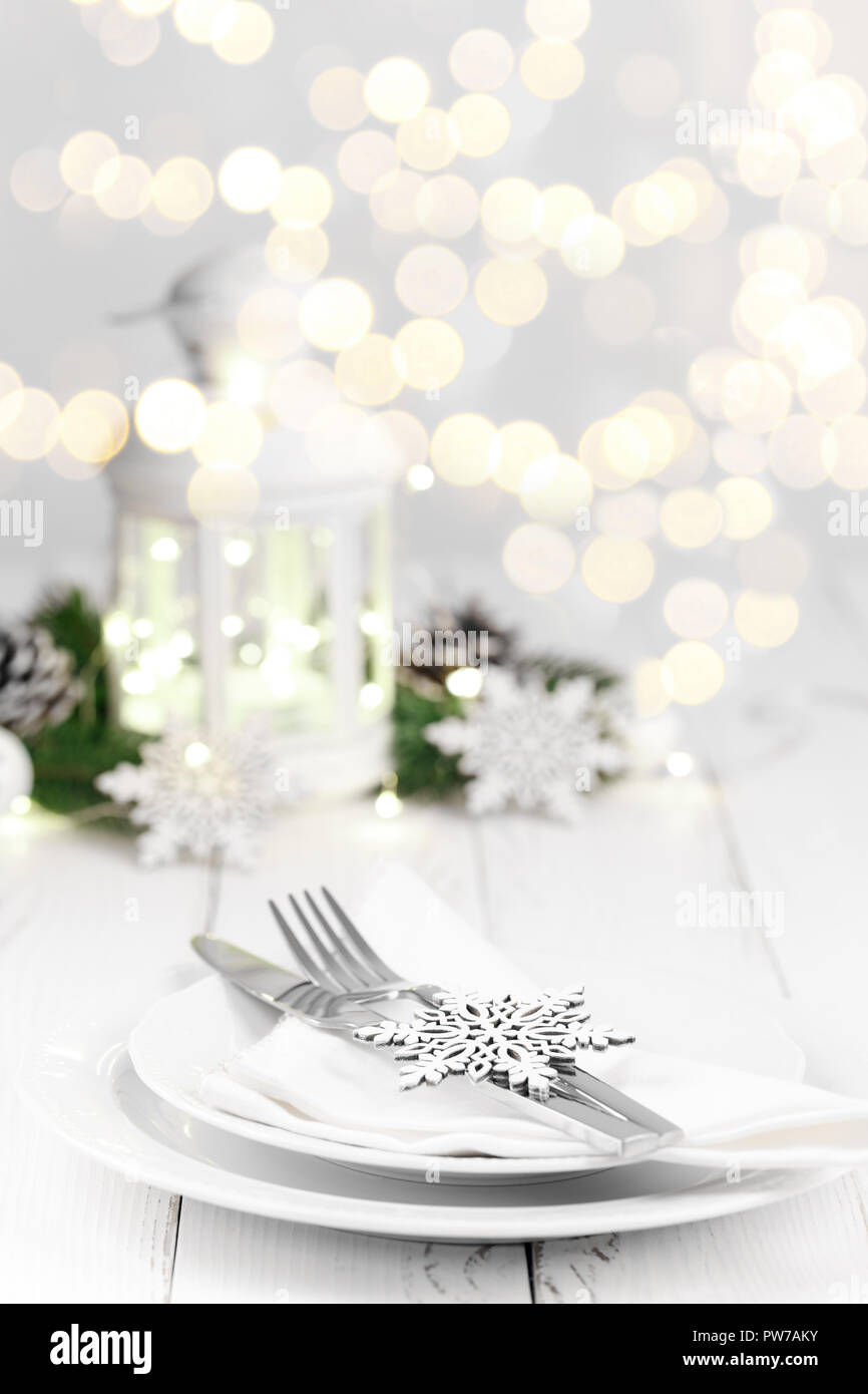 christmas or new year table setting on white wooden table christmas card or menu template