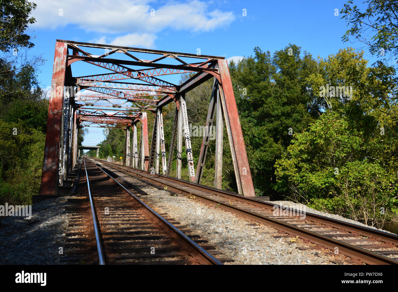 Looking down the tracks at a steel trestle bridge over the Tar River in Rocky Mount, North Carolina. Stock Photo