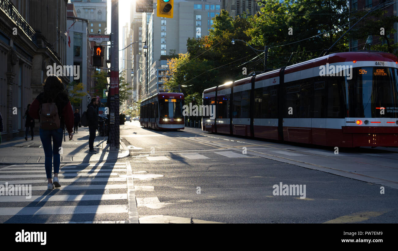 Two streetcars on King Street in Toronto. - Stock Image