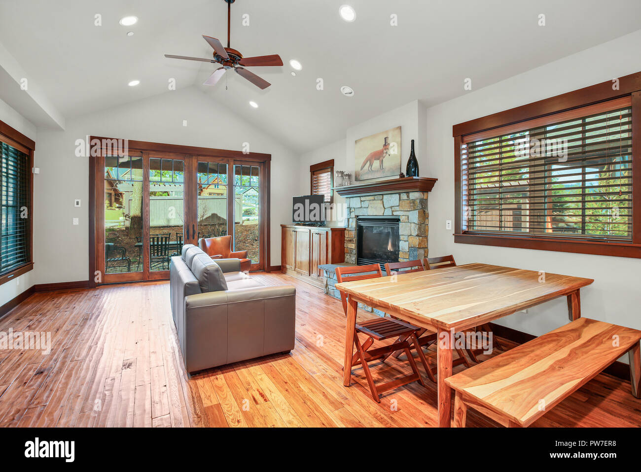 Open Floor Plan Design Of A Living Room And Dining With Vaulted Ceiling Wood Flooring Northwest USA