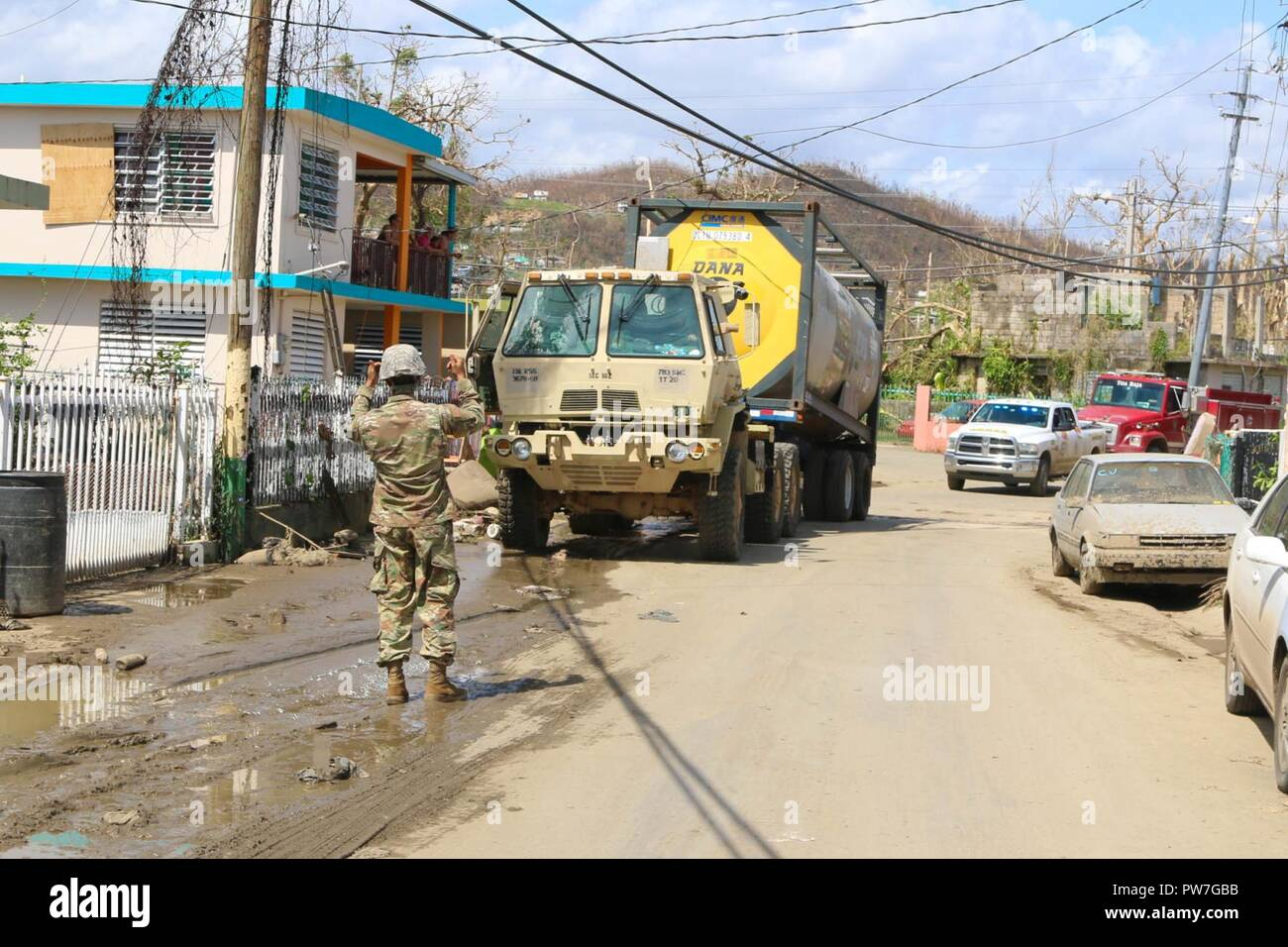Puerto Rico National Guard Citizen – Soldiers stationed at 783rd Maint. Co. in Toa Baja, PR continue supporting this city after Hurricane María, this time transporting more than 6000 gallons of water to the San José community, Sept. 24. - Stock Image