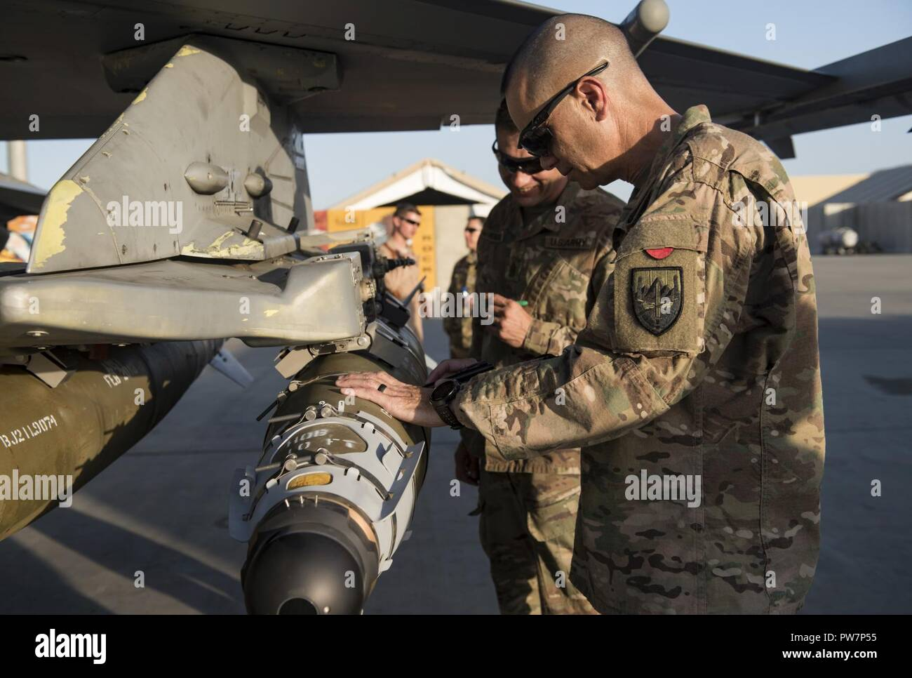U.S. Army Maj. Gen. Leopoldo Quintas, the deputy commanding general of U.S. Forces Afghanistan, signs a bomb during a visit of the 455th Air Expeditionary Wing at Bagram Airfield, Afghanistan, Sept. 26, 2017. During his immersion of the 455th AEW, Quintas saw firsthand how Airmen deliver airpower and enable a successful train, advise, and assist campaign in Afghanistan. Stock Photo