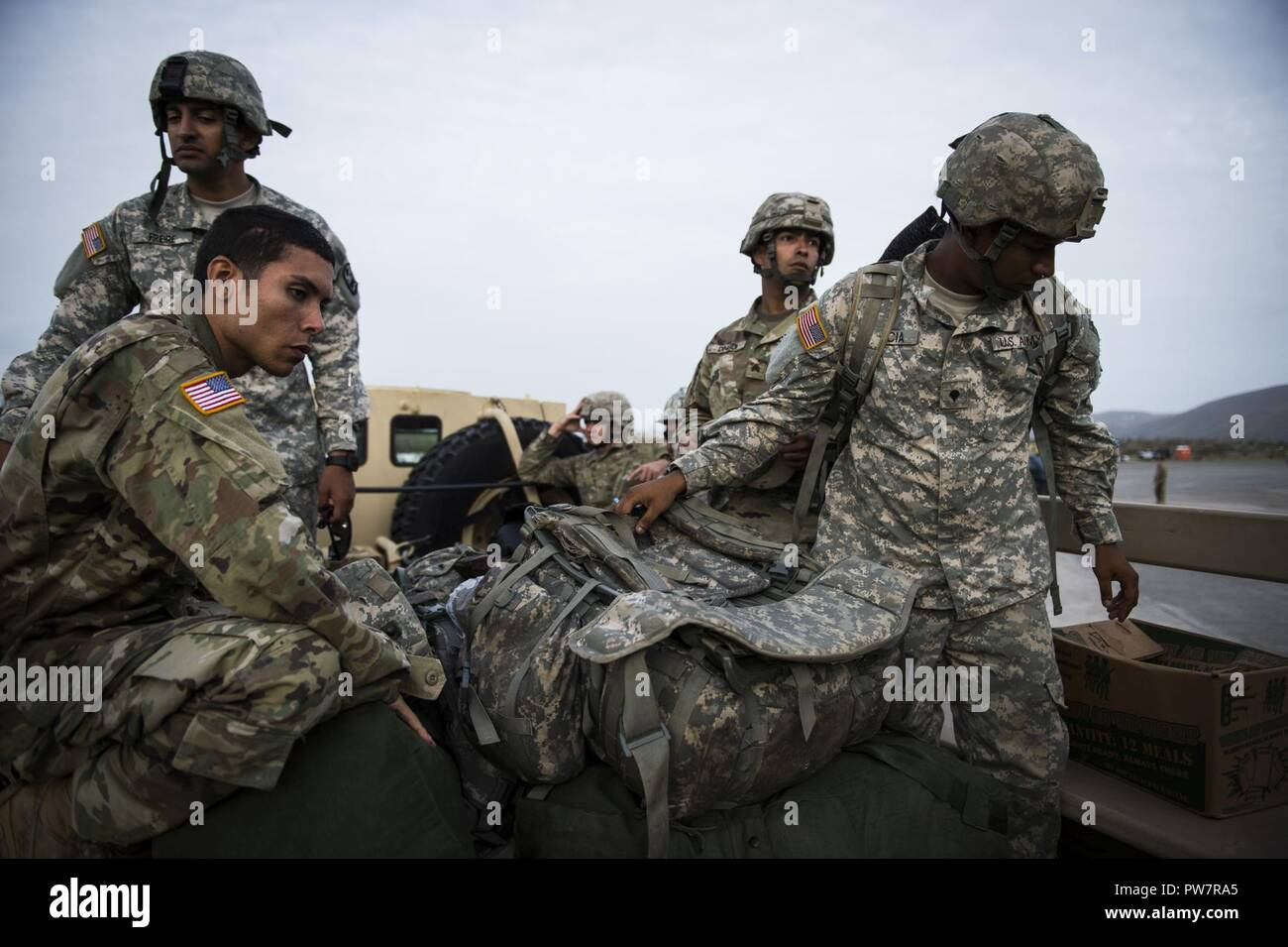 US Army Soldiers Assigned To The Puerto Rico National Guards 1st Battalion 65th Infantry Regiment Off Load Their Gear At St Thomas Virgin Islands