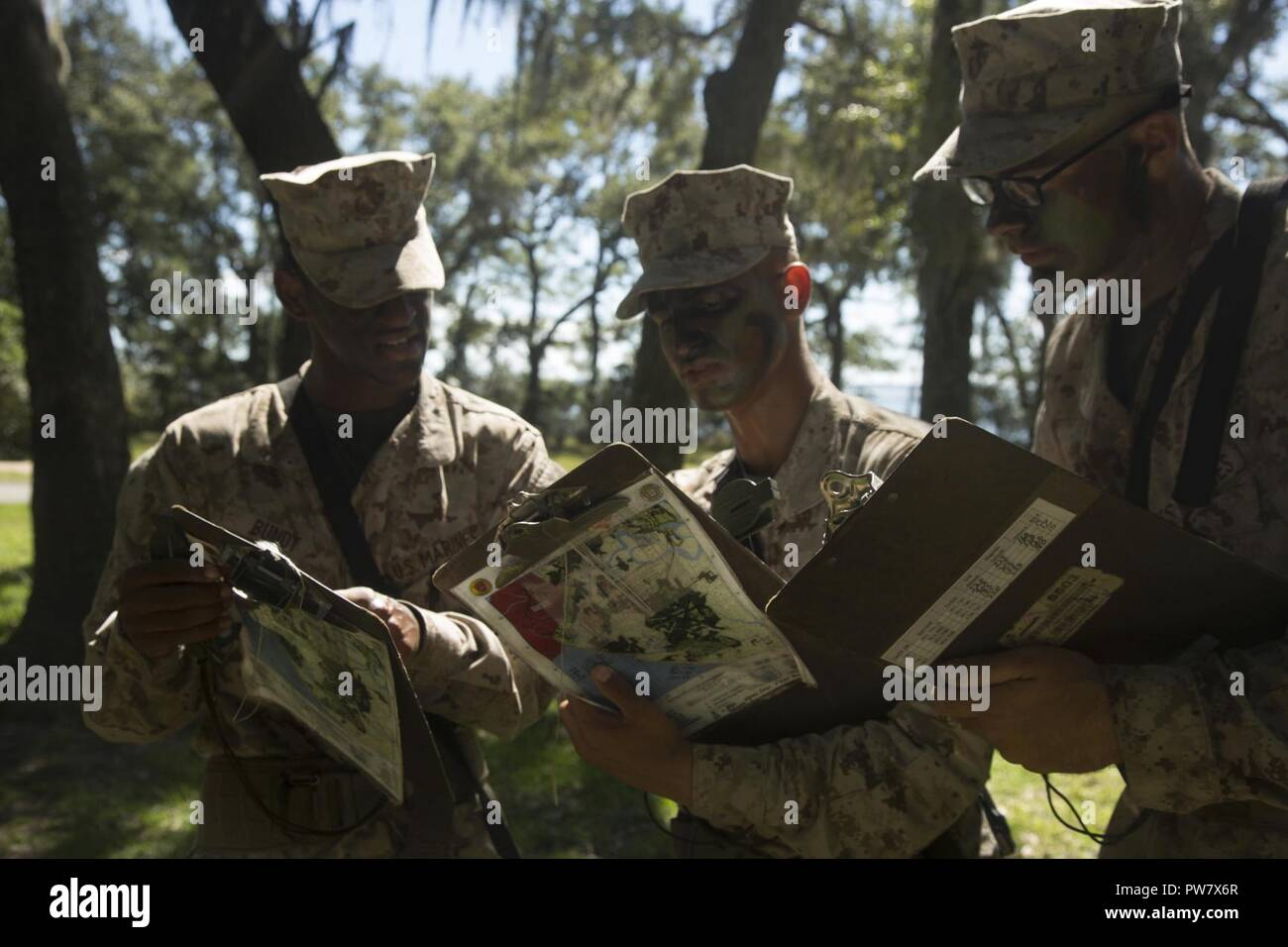 U.S. Marine Corps Recruits with Delta Company, 1st Battalion, Recruit Training Regiment, record their plot points at Elliot's Beach on Marine Corps Recruit Depot, Parris Island, S.C., Sept. 25, 2017.  The Land Navigation Course teaches recruits how to properly navigate unfamiliar terrain. Stock Photo