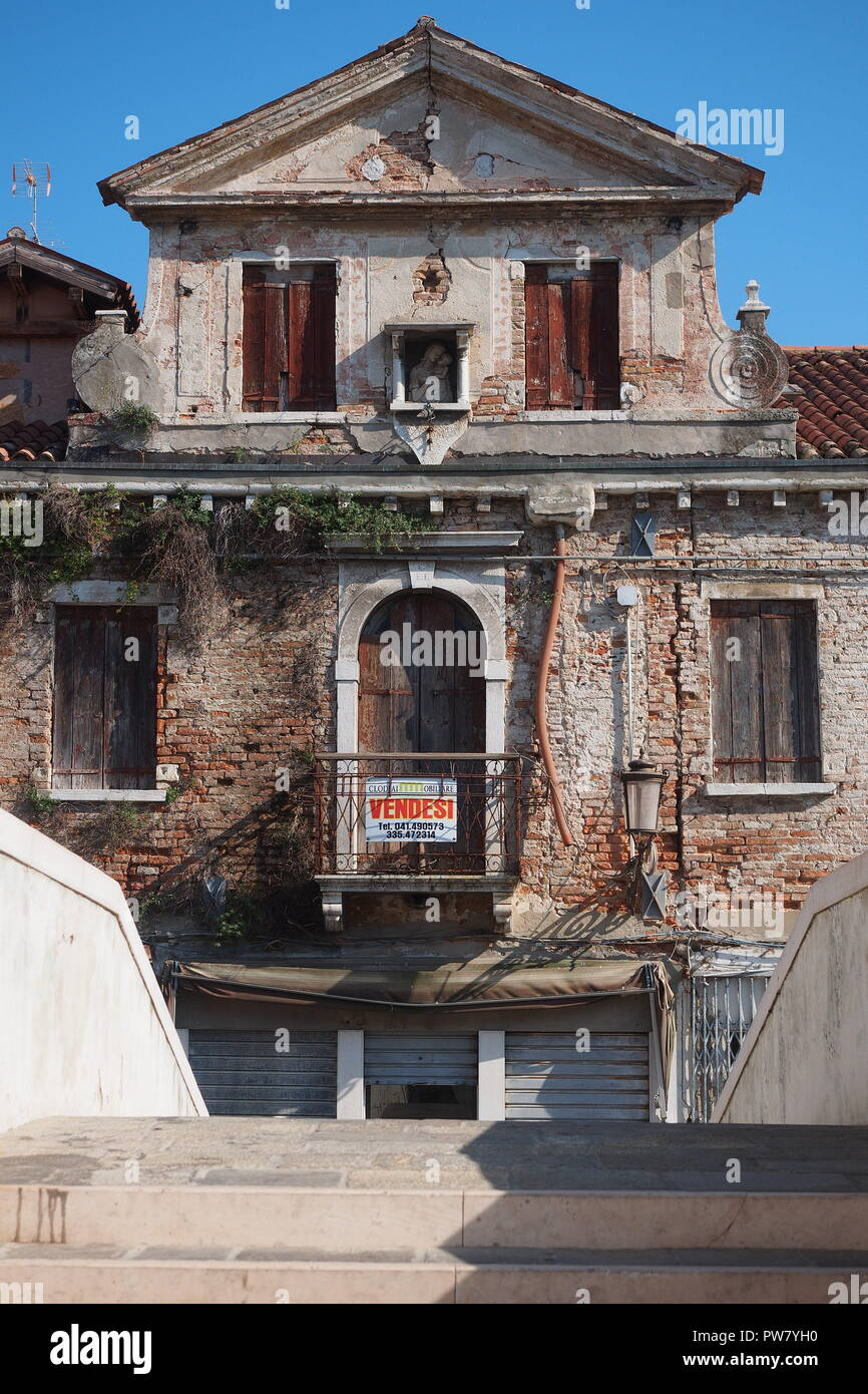 Old run-down house in chioggia for sale, Italy - Stock Image