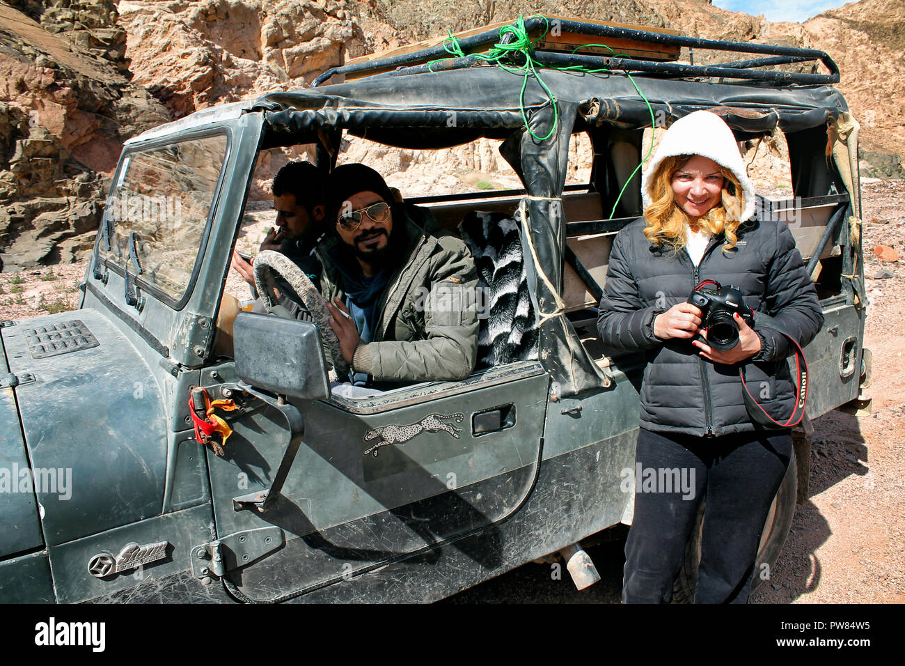 Lady with tour guides in the way to Colour Canyon. South Sinai. Egypt - Stock Image