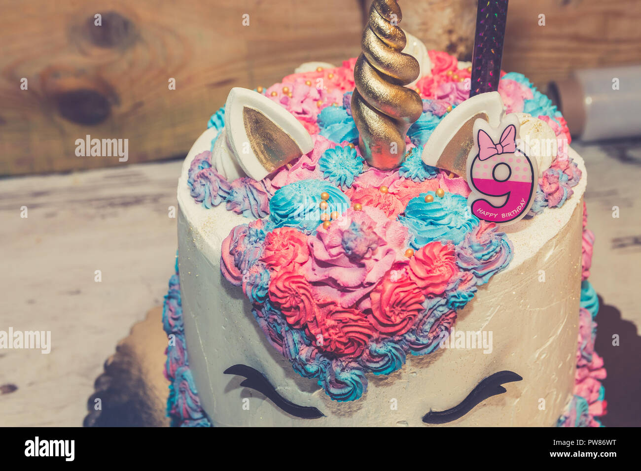 Unicorn Birthday Cake For Little Girls Decorated With Colorful Whipped Cream And Number Nine On The Top Close Up