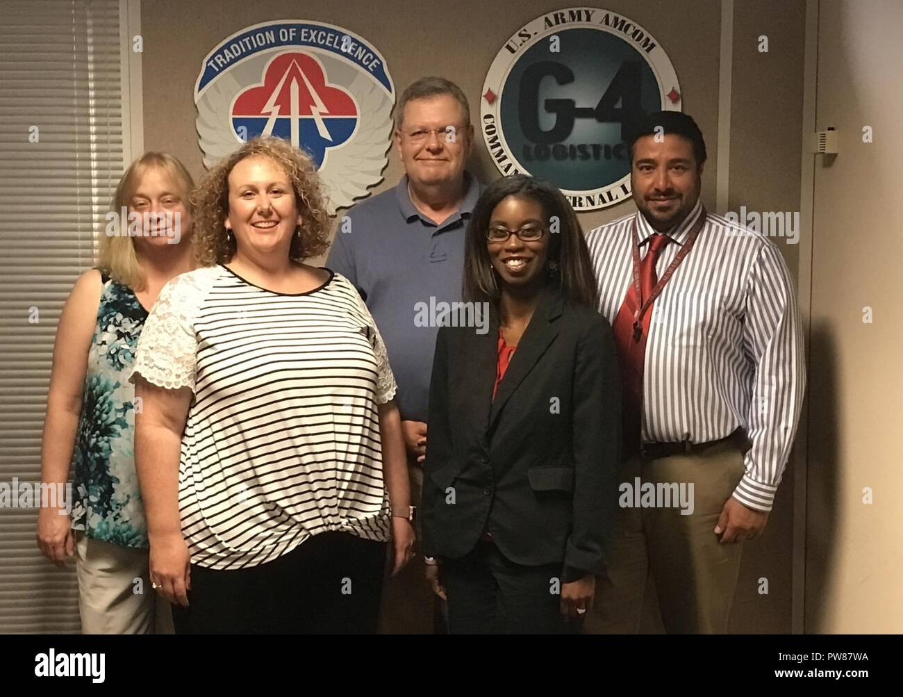 The Aviation and Missile Command's G-4 Environmental Hot Line Team is responsible for reviewing UH-72 Lakota consumables materials for compliance with new air regulations and for providing recommended substitutions when necessary. The team includes, from left, Leslie Hasenbein, Sheree York, team lead Mark Feathers, LaDonna McCann and Zubin Dutia. Not pictured is Paul Robinson. - Stock Image