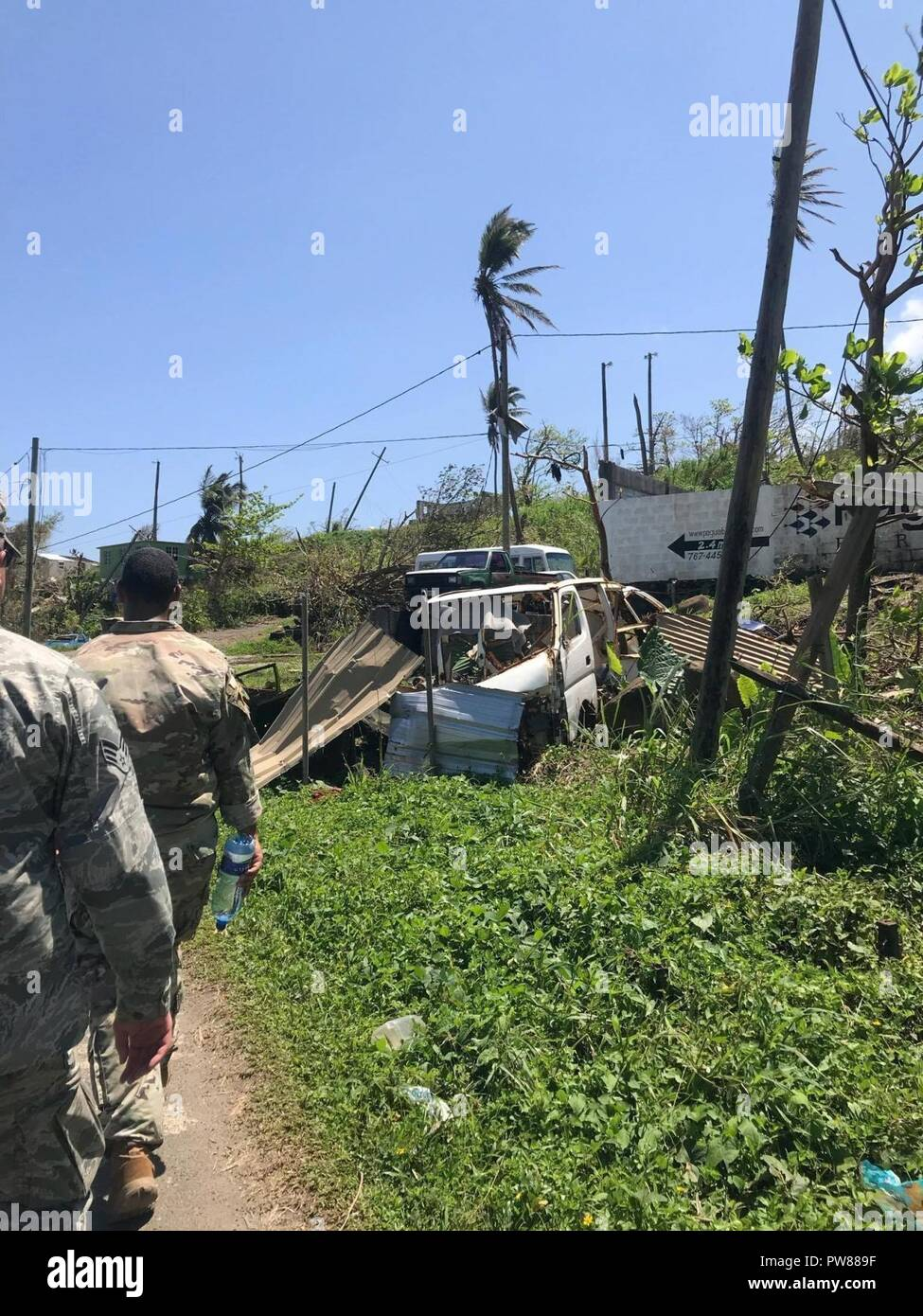 U.S. service members survey damage, Oct. 9, 2017 on the Caribbean island of Dominica. The island was devastated by Hurricane Maria, a Category 5 storm that made landfall Sept. 19, 2017, spurring support from the Joint Base Lewis-McChord community, as well as military installations across the globe. - Stock Image
