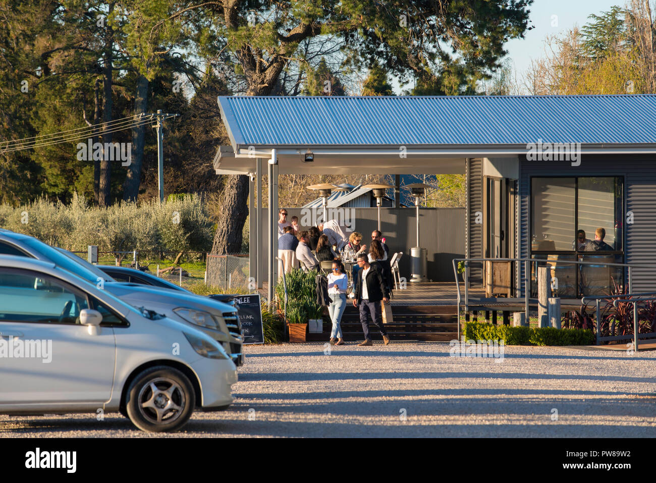 People sampling, tasting and buying wine at the tasting room of Rowlee Wines at Nashdale near Orange in New South Wales, Australia - Stock Image