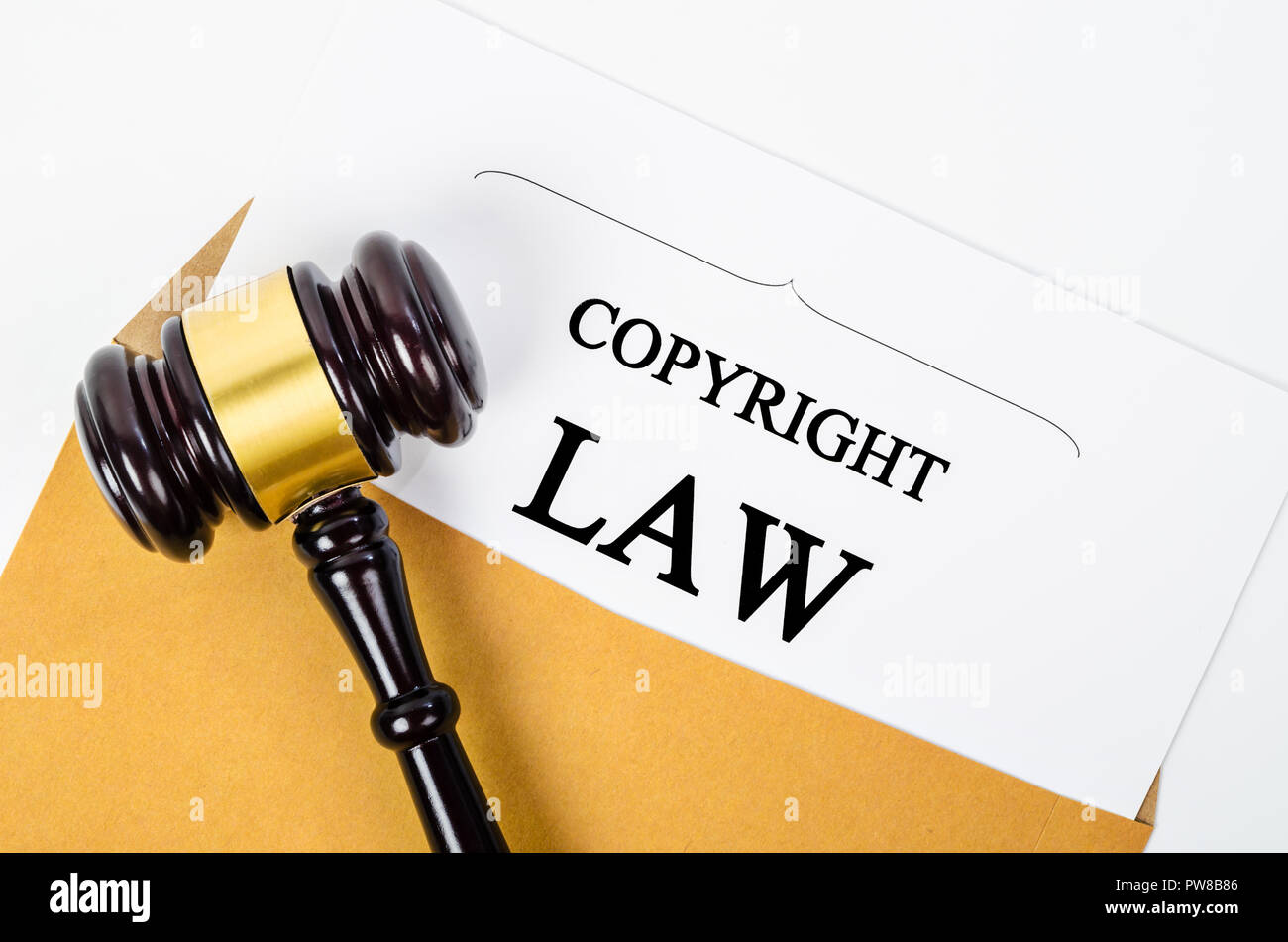 Copyright law document and a judge gavel. concept of legal education. - Stock Image