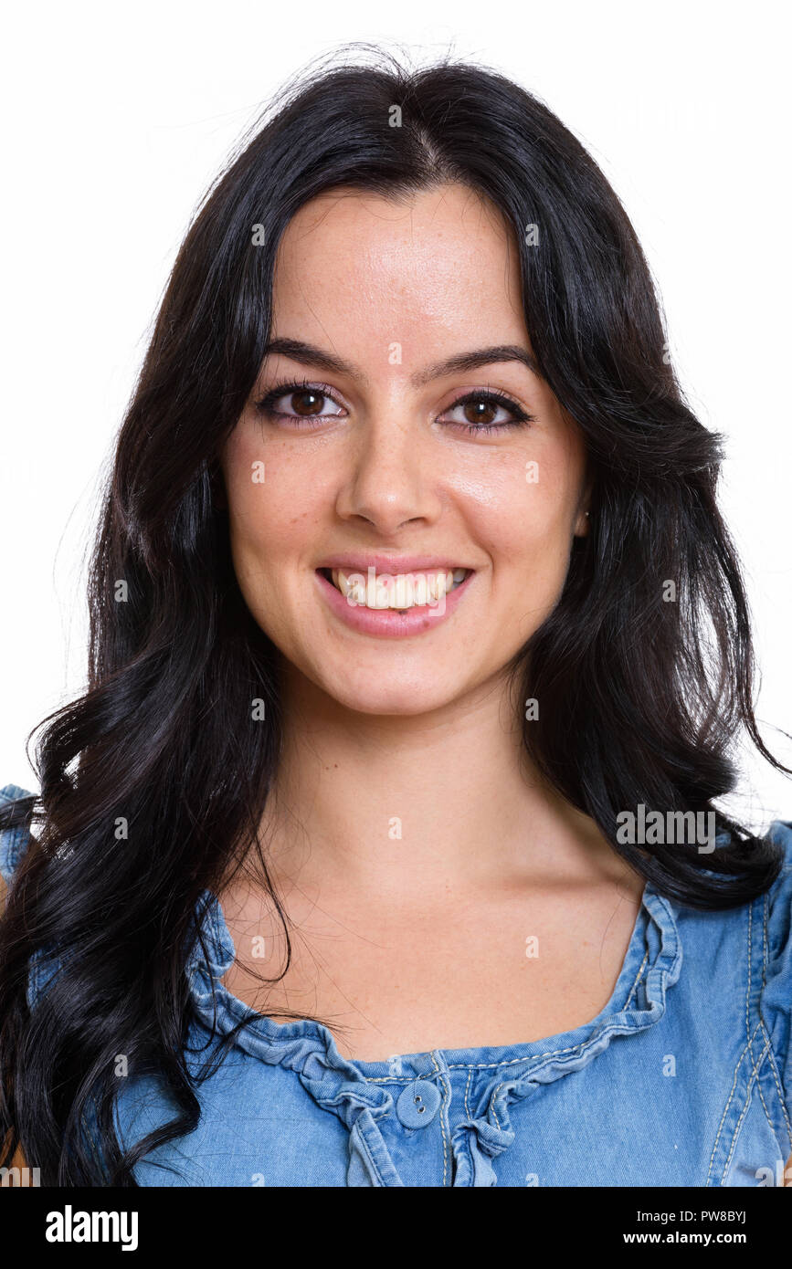Face Of Young Happy Spanish Woman Smiling Stock Photo