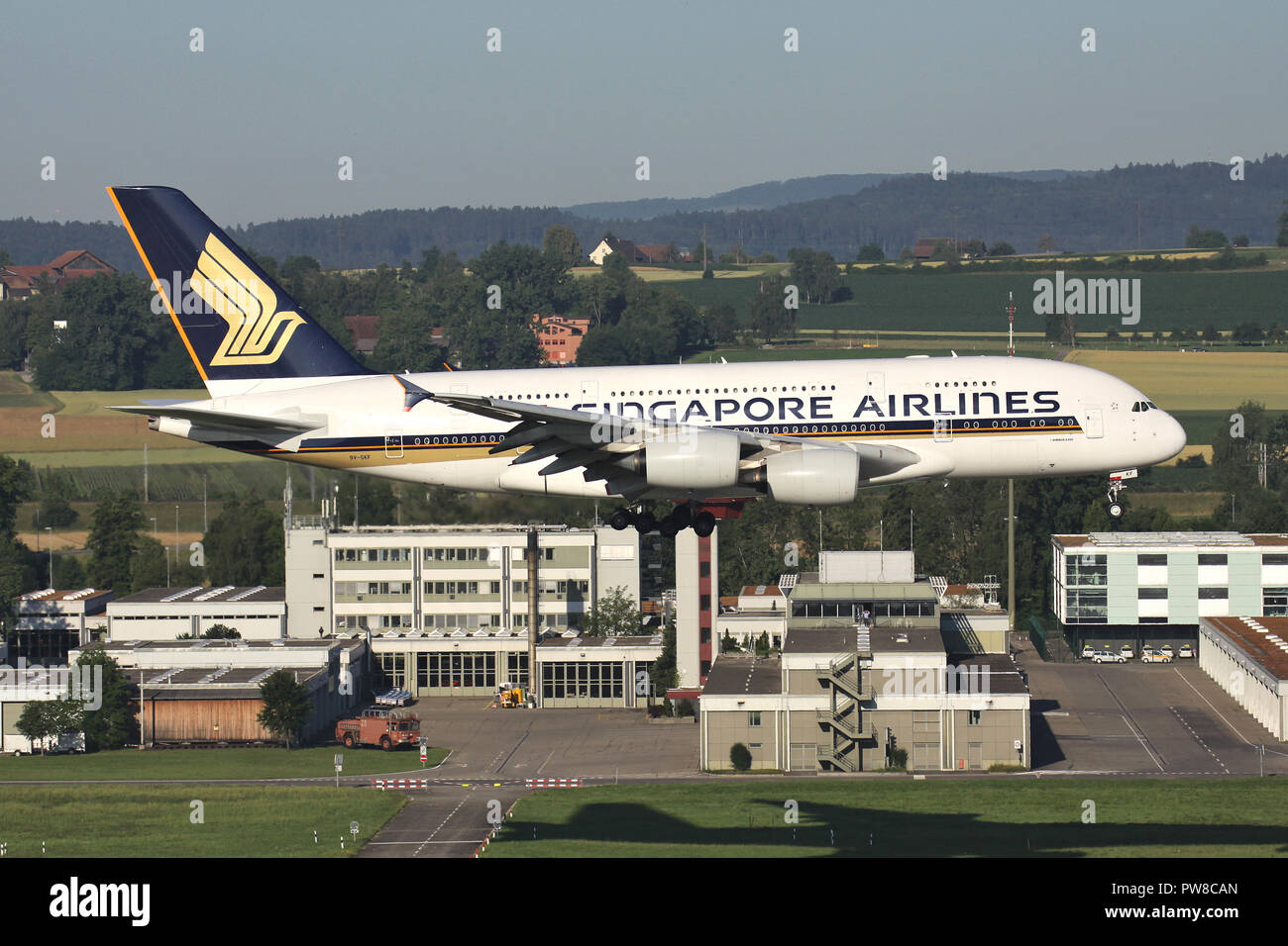 Singapore Airlines Airbus A380 with registration 9V-SKF on short final for runway 34 of Zurich Airport. - Stock Image
