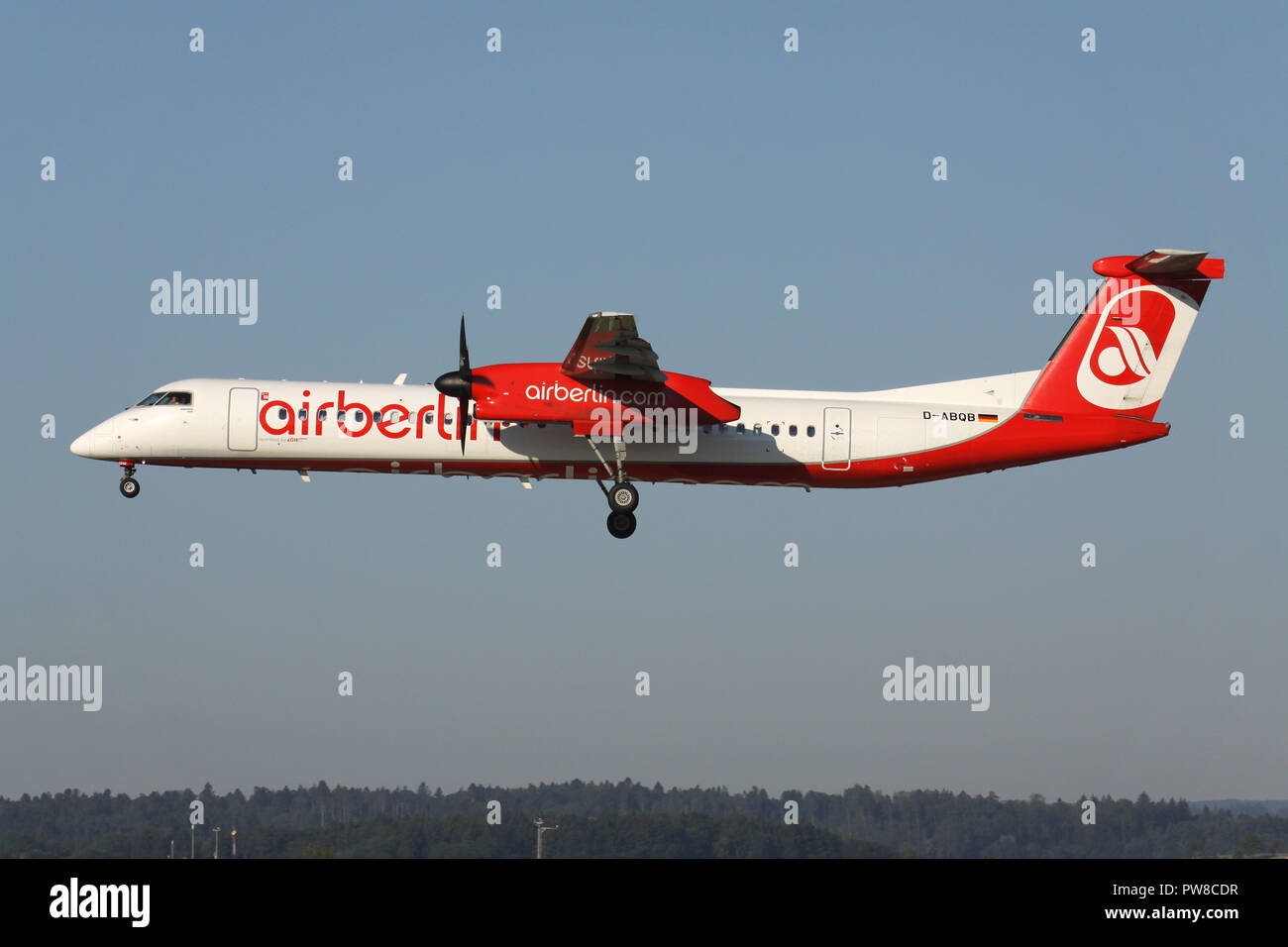 German LGW Bombardier Dash 8 Q400 in Air Berlin livery with registration D-ABQB on short final for runway 14 of Zurich Airport. - Stock Image