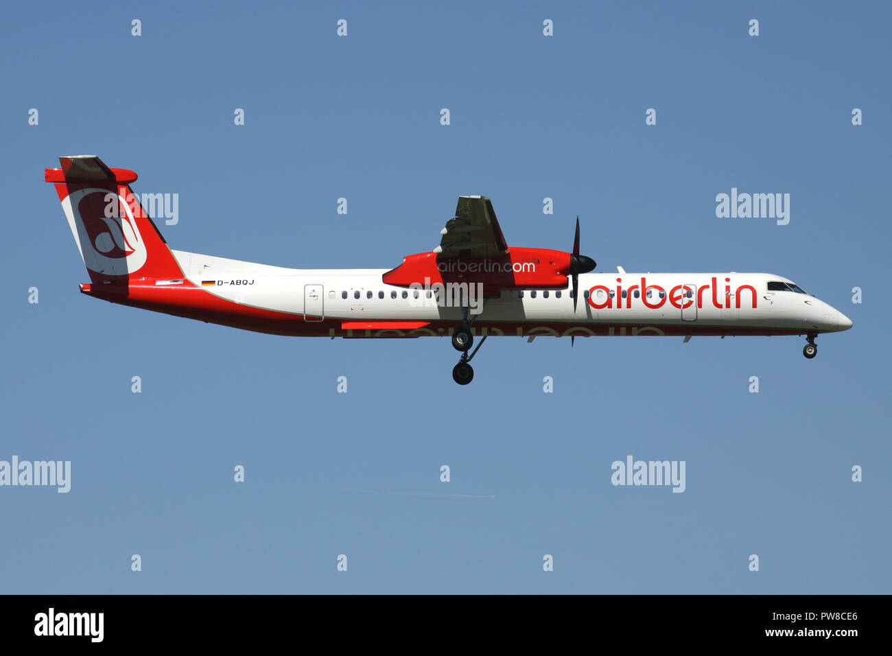 German LGW Bombardier Dash 8 Q400 in Air Berlin livery with registration D-ABQJ on short final for runway 14 of Zurich Airport. - Stock Image