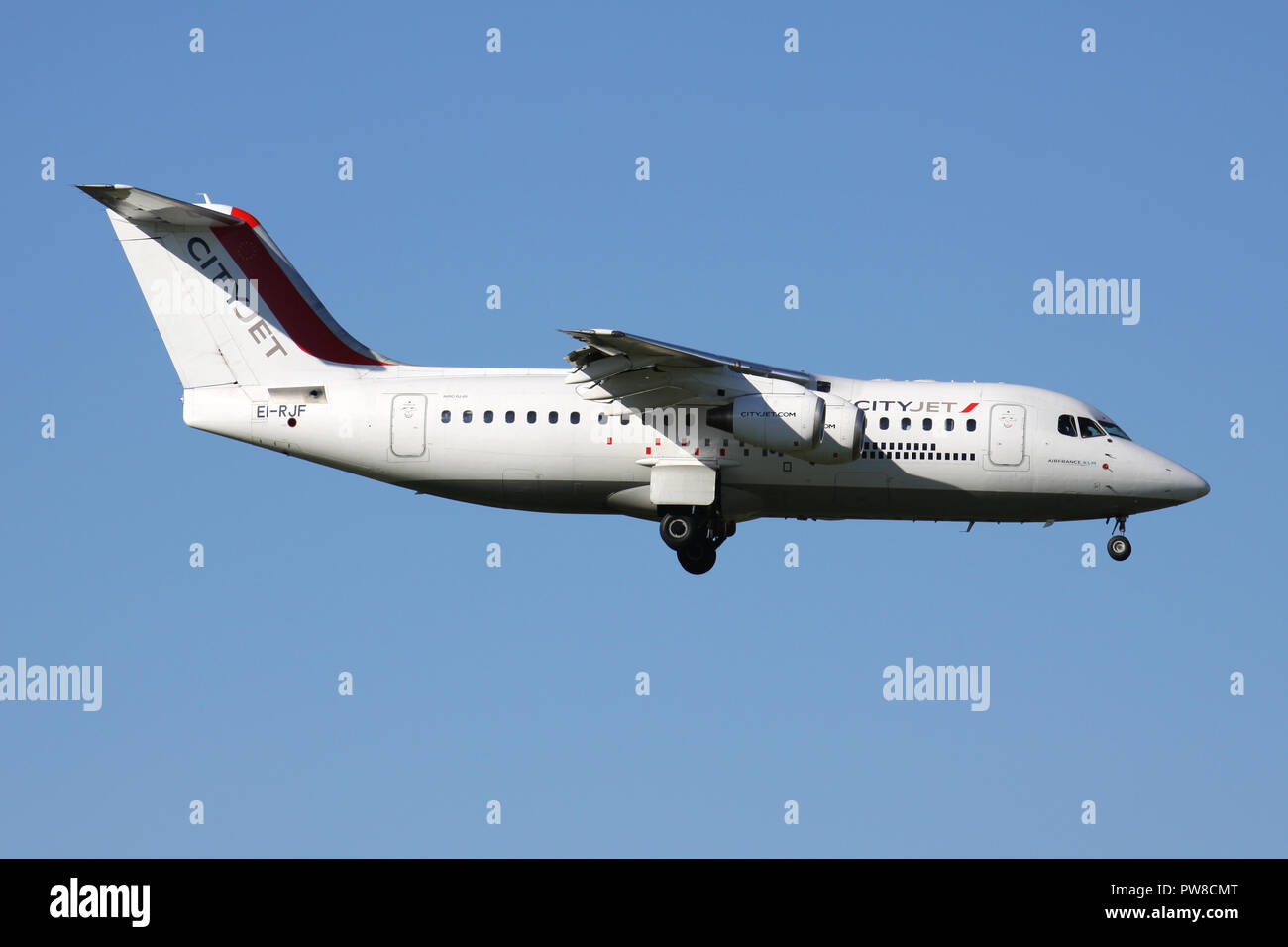 CityJet Avro RJ85 (old livery) with registration EI-RJF on short final for runway 14 of Zurich Airport. - Stock Image