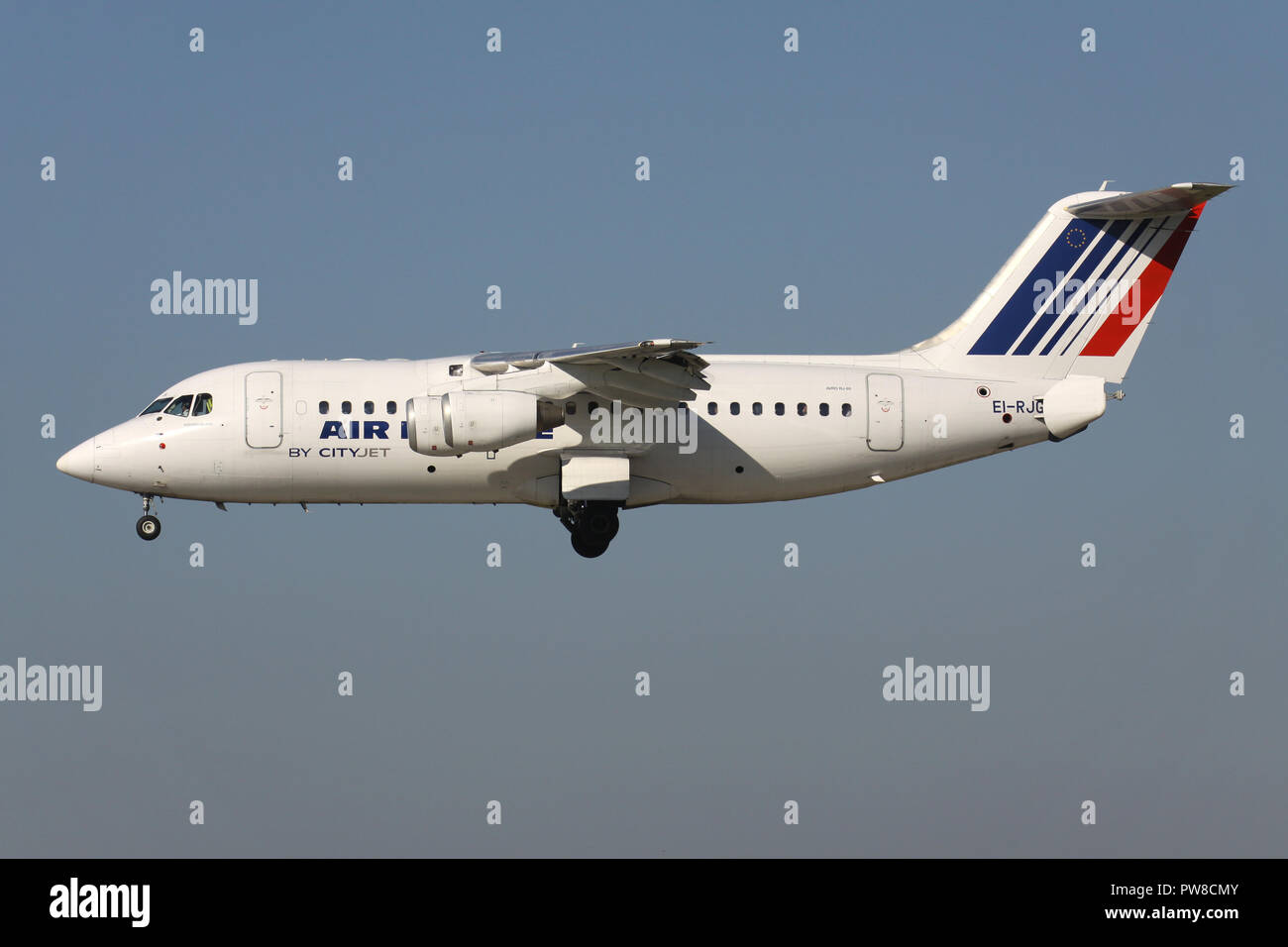 CityJet Avro RJ85 in old Air France livery with registration EI-RJG on short final for runway 14 of Zurich Airport. - Stock Image
