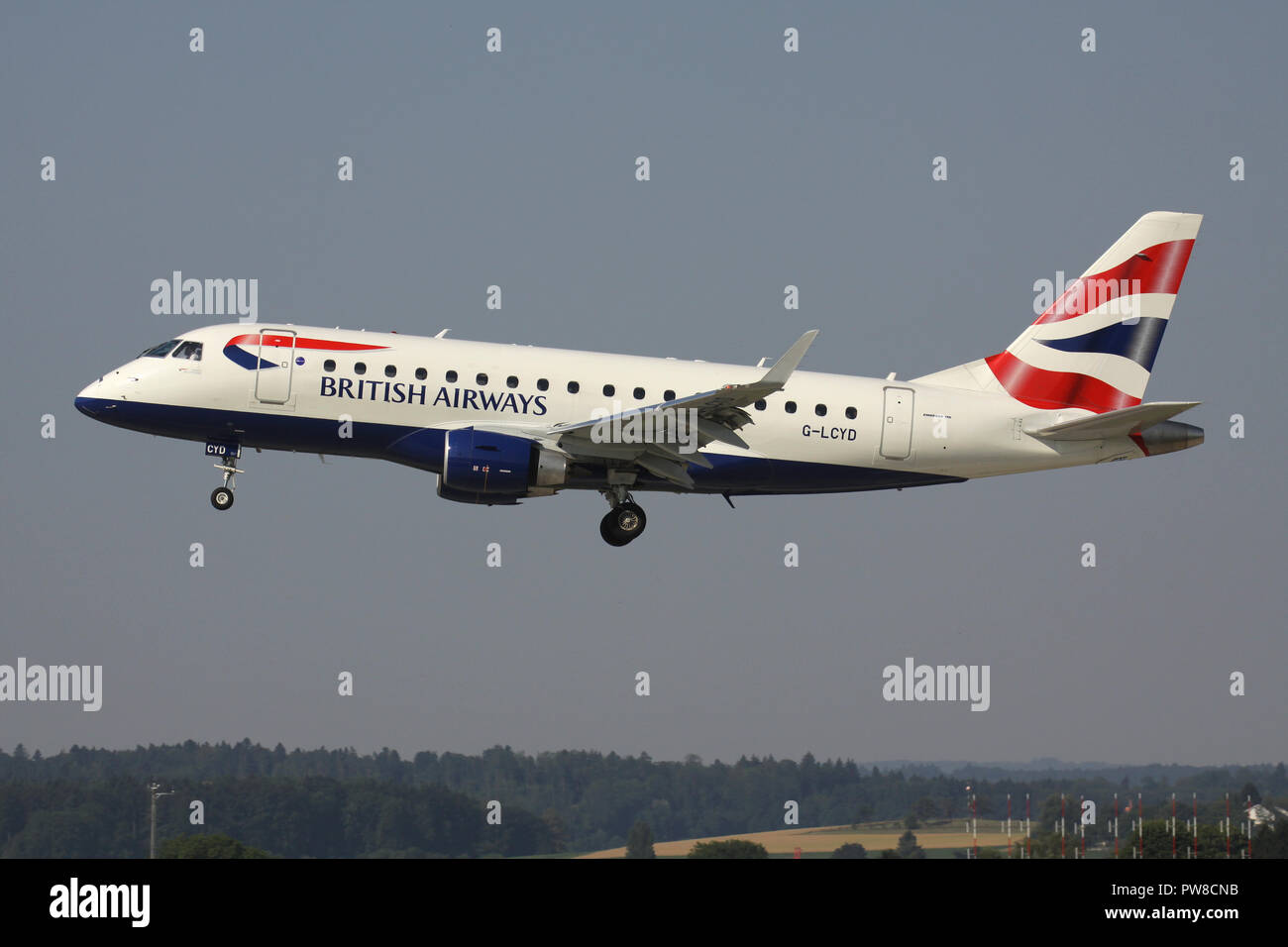 BA Cityflyer ERJ-170 with registration G-LCYD on short final for runway 14 of Zurich Airport. Stock Photo