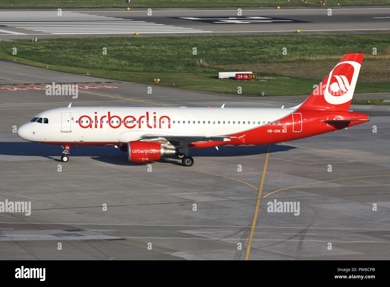 Swiss Belair Airbus A320-200 in Air Berlin livery with registration HB-IOW on taxiway of Zurich Airport. - Stock Image