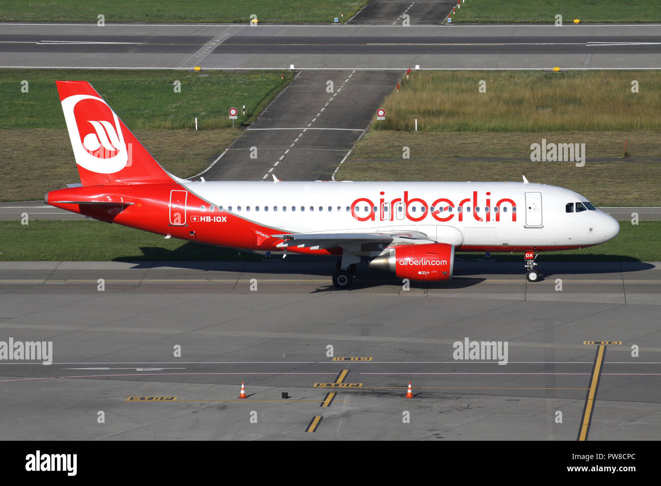 Swiss Belair Airbus A319-100 in Air Berlin livery with registration HB-IOX on taxiway of Zurich Airport. - Stock Image