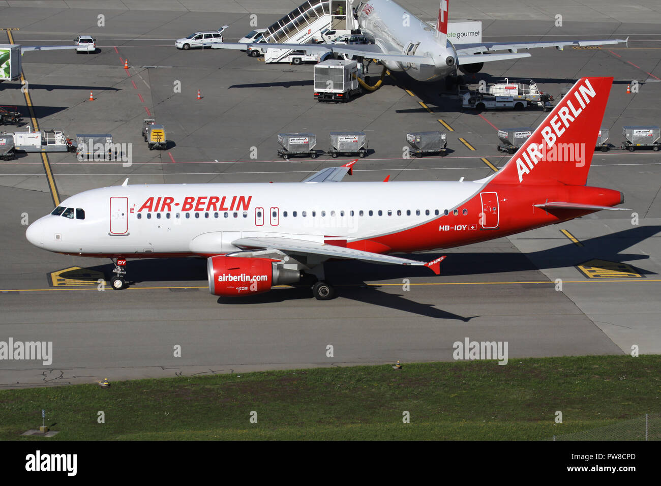 Swiss Belair Airbus A319-100 in old Air Berlin livery with registration HB-IOY on taxiway of Zurich Airport. - Stock Image