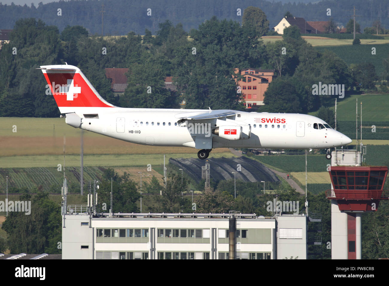 Swiss International Air Lines Avro RJ100 (old livery) with registration HB-IXQ on short final for runway 34 of Zurich Airport. Stock Photo