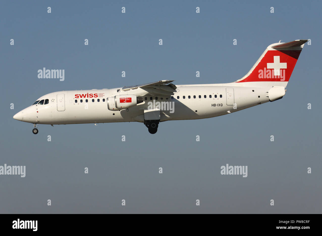Swiss International Air Lines Avro RJ100 (old livery) with registration HB-IXQ on short final for runway 14 of Zurich Airport. Stock Photo