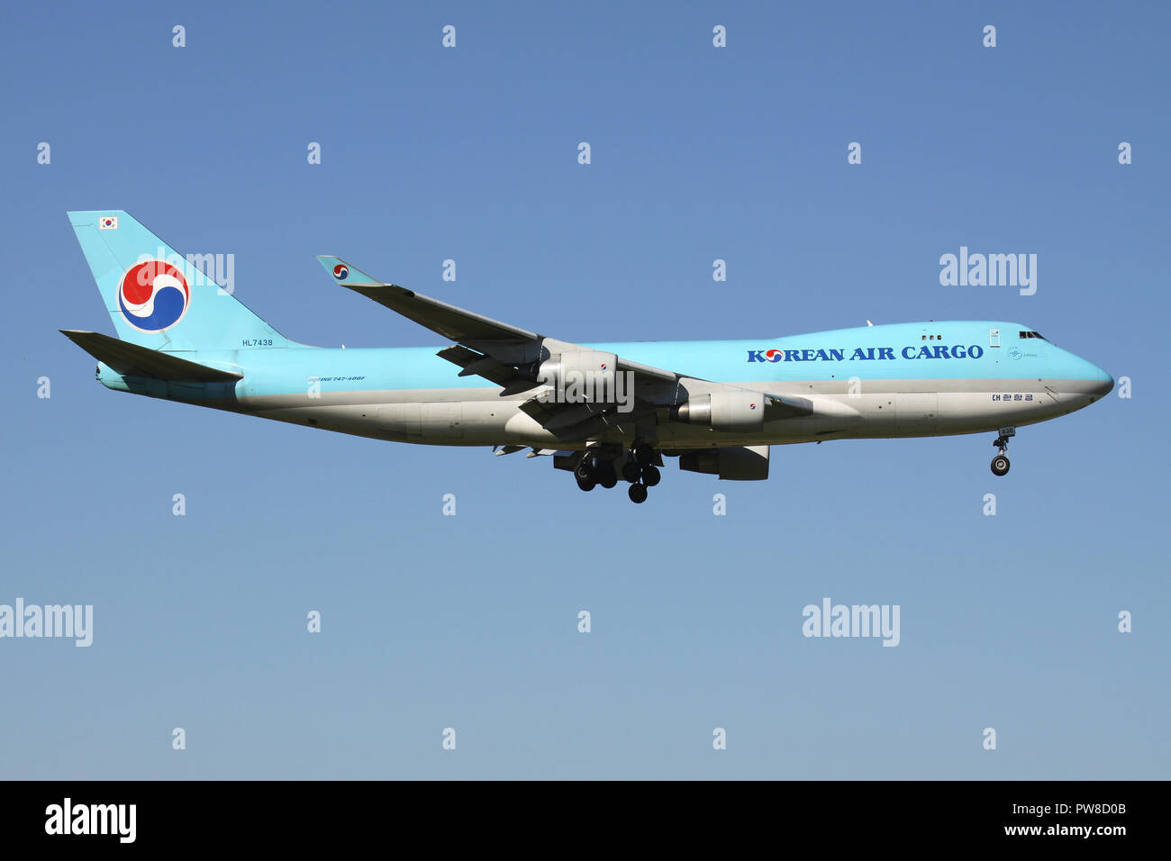 Korean Air Cargo Boeing 747-400F with registration HL7438 on short final for runway 14 of Zurich Airport. - Stock Image