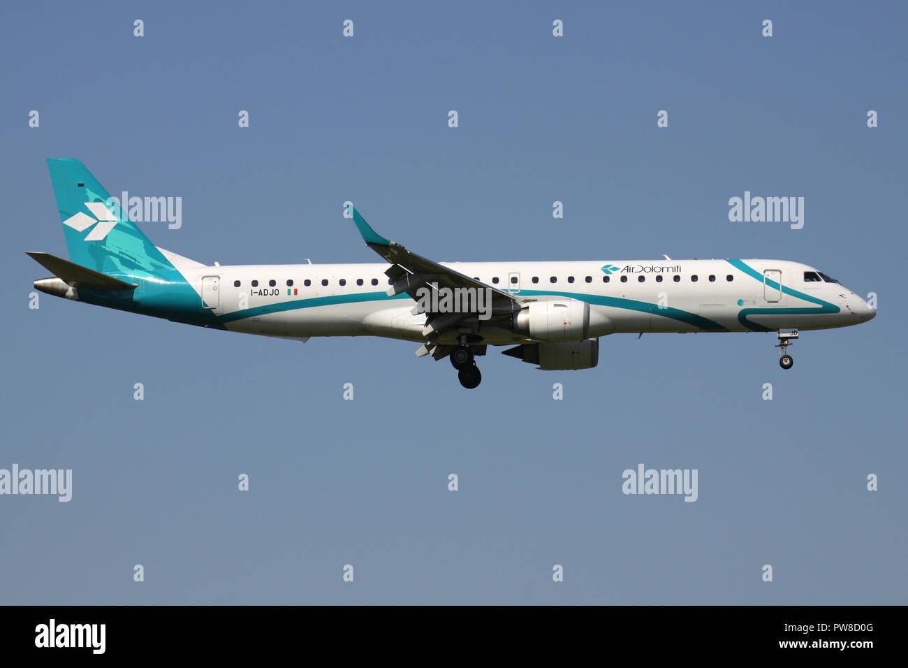 Italian Air Dolomiti ERJ-195 with registration I-ADJO on short final for runway 14 of Zurich Airport. - Stock Image