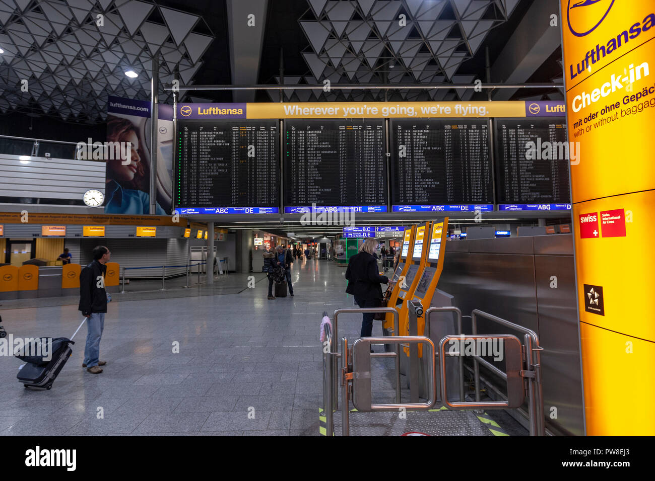 Automatic Lufthansa check in facilities in Frankfurt Airport in Frankfurt, Germany. - Stock Image