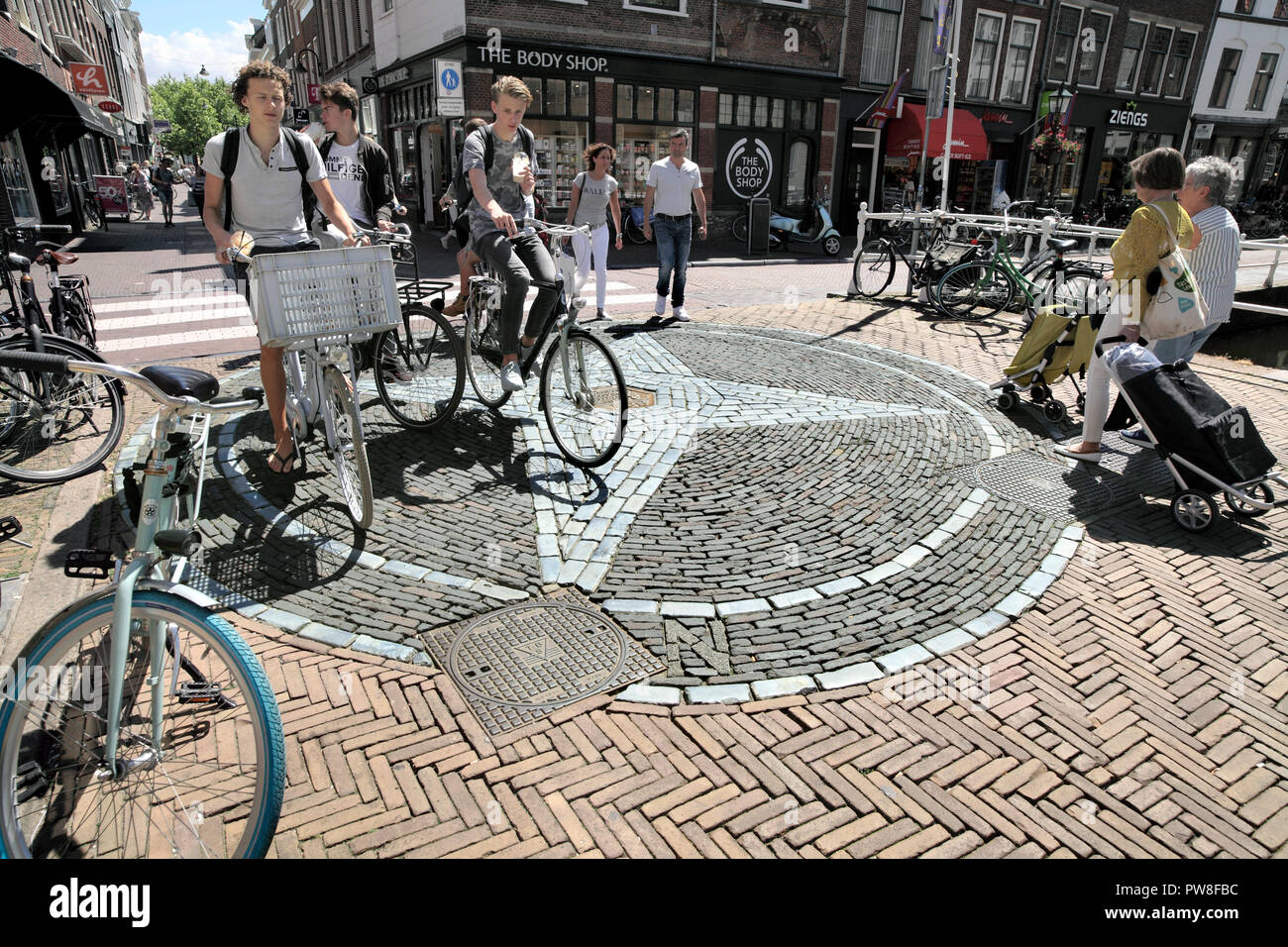 The four points of the compass set in brickwork in a pedestrianised part of  Delft town centre. South Holland, The Netherlands. - Stock Image