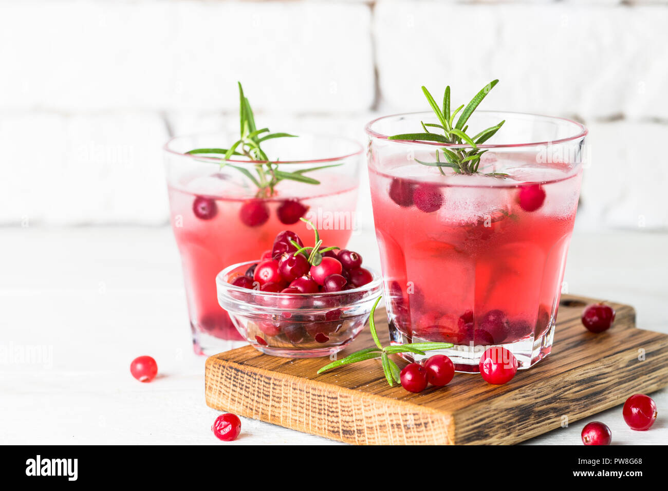 Cocktail with cranberry, vodka, rosemary and ice. - Stock Image