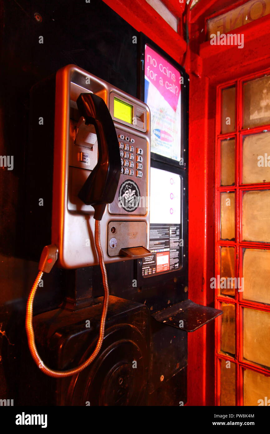 A BT public payphone inside a UK Red Telephone Box - Stock Image