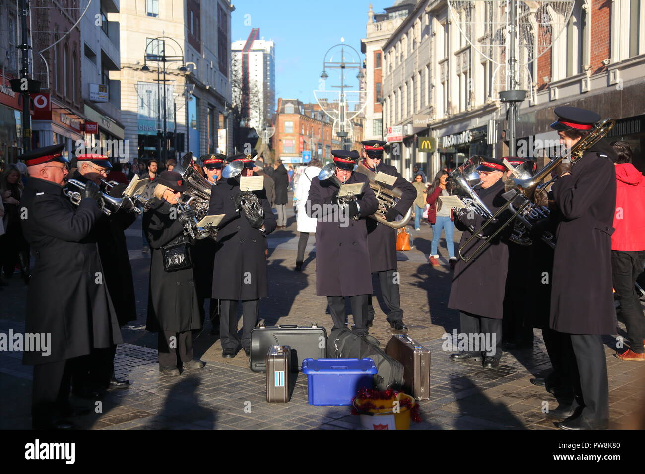 Salvation Army playing music on Briggate in Leeds - Stock Image