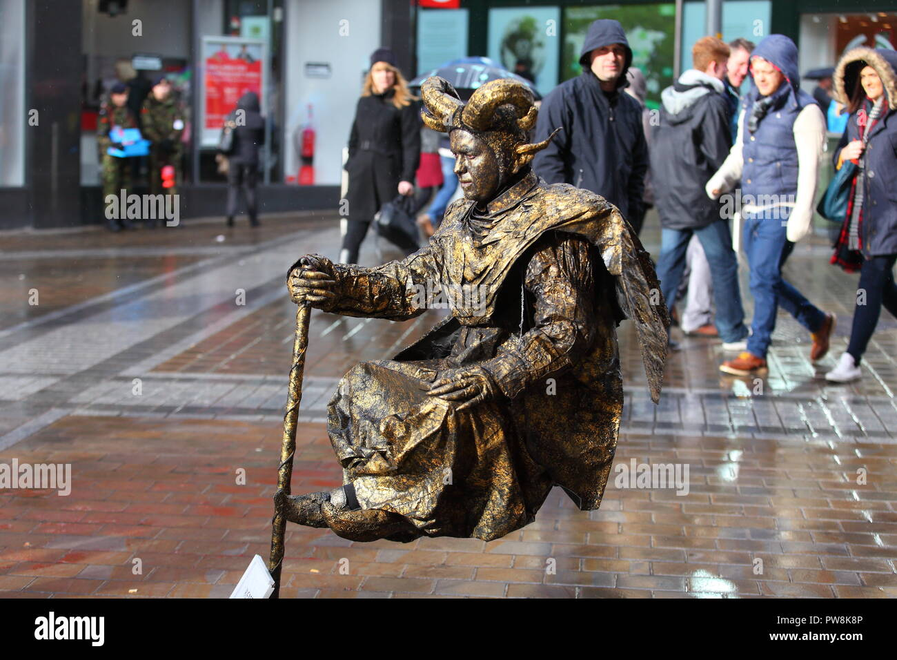A living statue busker appears to be levitating on Briggate in Leeds - Stock Image