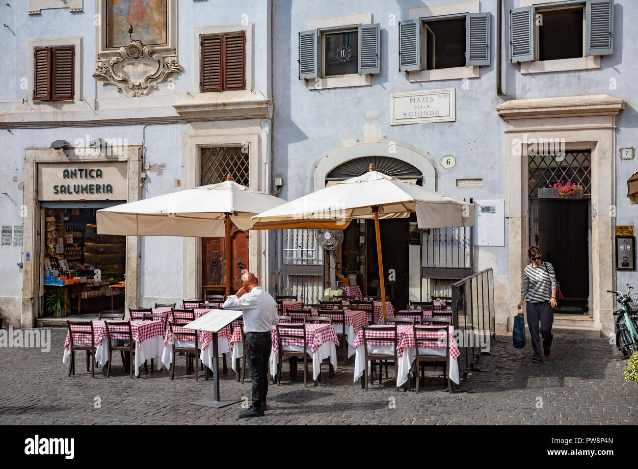 Waiters and italian restaurant with traditional red tablecloths in piazza della rotunda,Rome,Italy - Stock Image