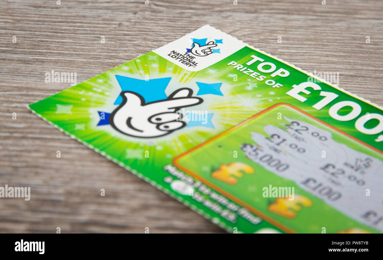 A National Lottery Scratchcard with a £5 win. - Stock Image