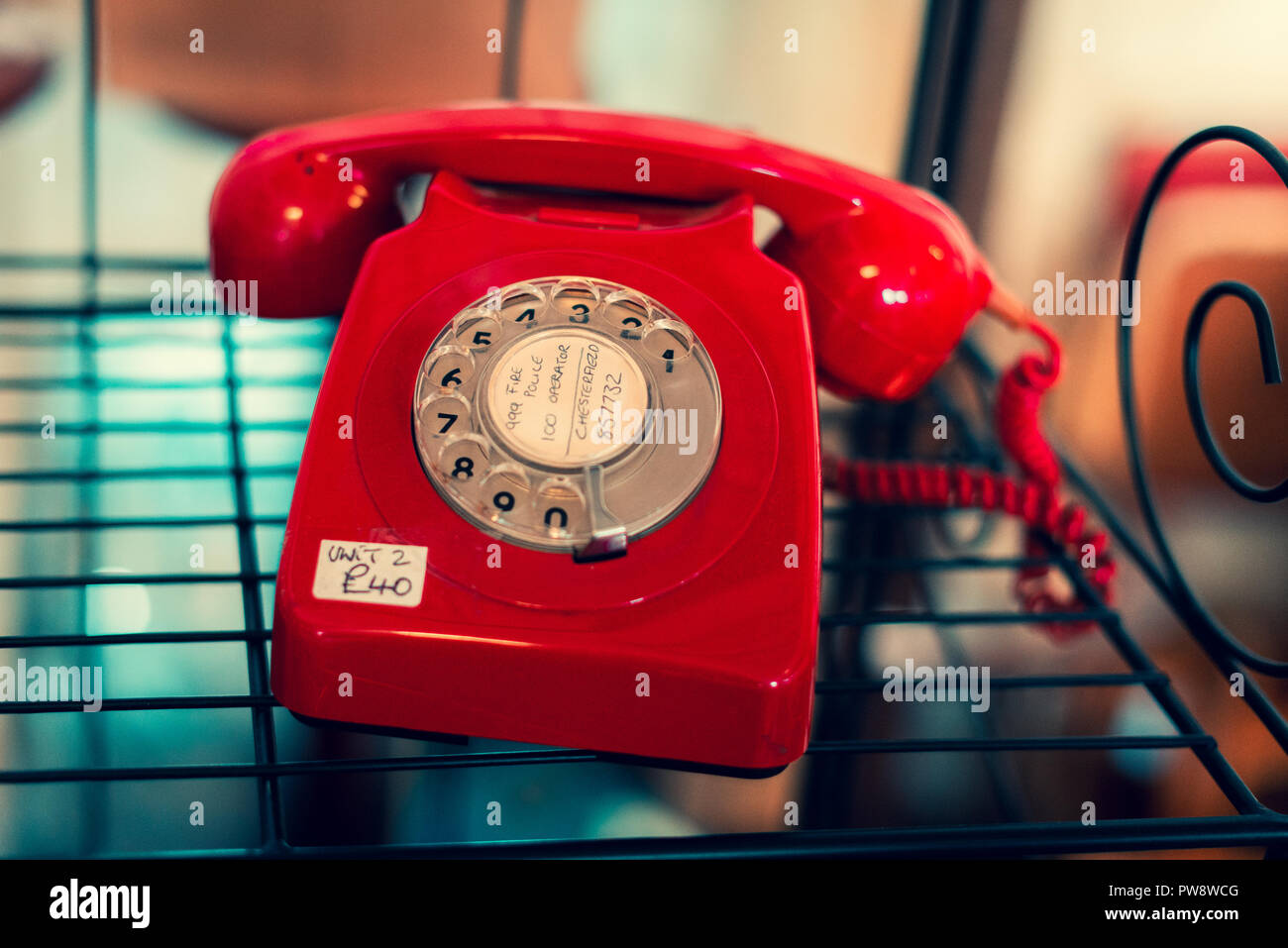A bright red old telephone for sale at an antique store in Sheffield Stock Photo