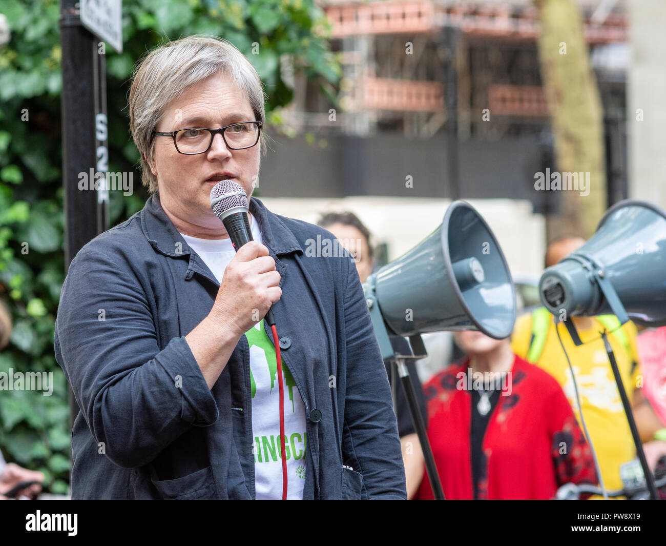 London, England, UK - October 13, 2018: Caroline Russell, Green Party Member of the London Assembly and national transport spokesperson, speaks at the 'Pedal On Parliament' event organised by Stop Killing Cyclists to call for greater investment in safe cycling infrastructure. Credit: Joe Dunckley/Alamy Live News - Stock Image