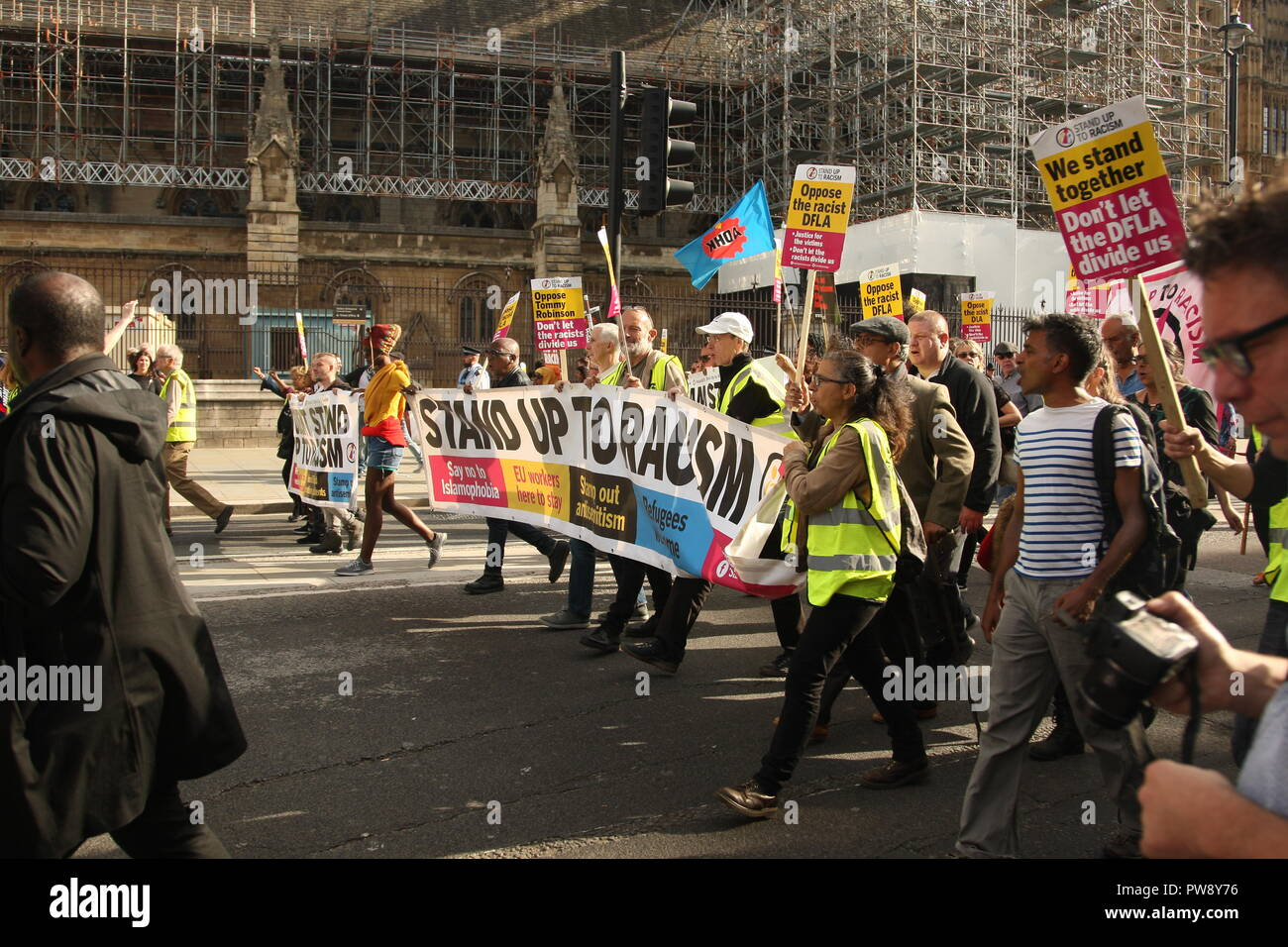 London, UK. 13th October, 2018. A counter protest organised by campaign group Stand Up To Racism held a march and rally in Whitehall. The purpose of the protest was to prevent the far right group DFLA (Democratic Football Lads Alliance) from marching through Whitehall and past Parliament. Roland Ravenhill/Alamy Live News - Stock Image