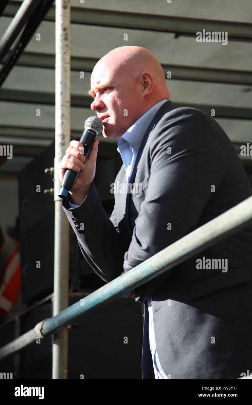 London, UK. 13th October, 2018. Steve Hedley, the Assistant General Secretary of the RMT union speaks at a counter protest organised by campaign group Stand Up To Racism.  The protest included a march and rally in Whitehall. The purpose of the protest was to prevent the far right group DFLA (Democratic Football Lads Alliance) from marching through Whitehall and past Parliament. Roland Ravenhill/Alamy Live News - Stock Image