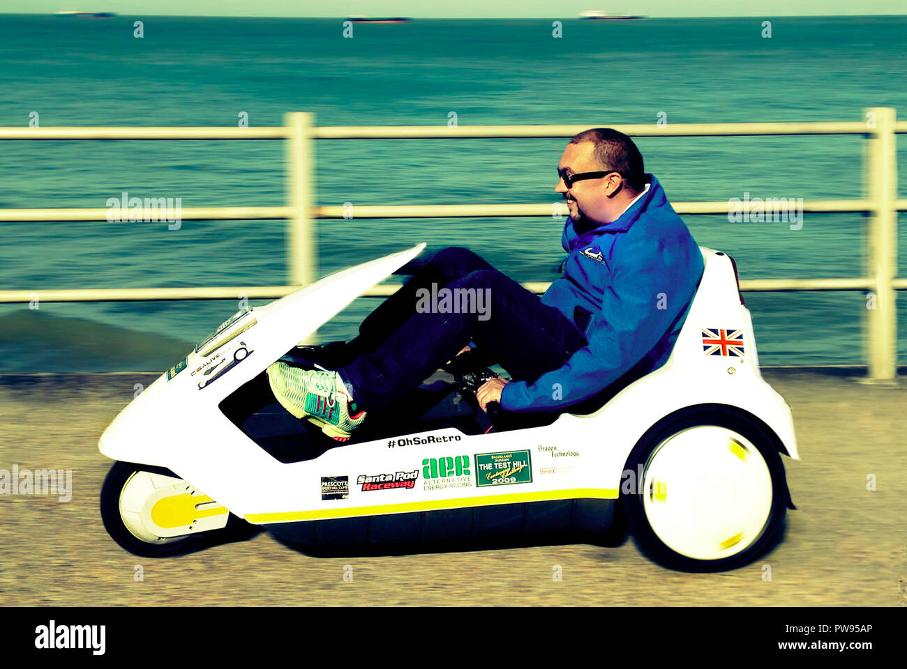 Margate, UK. 13th October 2018. Tourist driving a classic 1985 Sinclair C5 electric vehicle on the Viking trail in Margate Kent UK 13/10/2018 Credit: Martyn Goddard/Alamy Live News - Stock Image